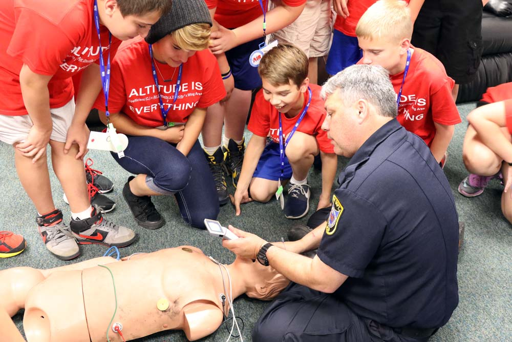 air camp students learning cpr