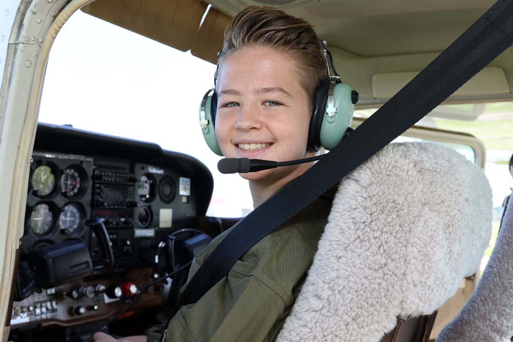 air camp student in plane