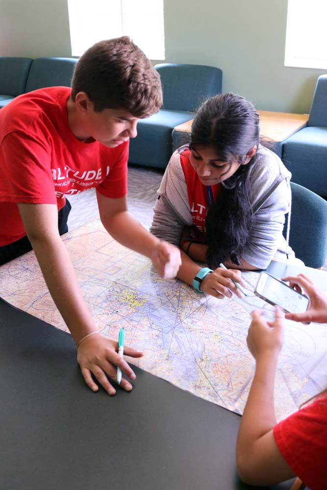 air camp students writing on a map