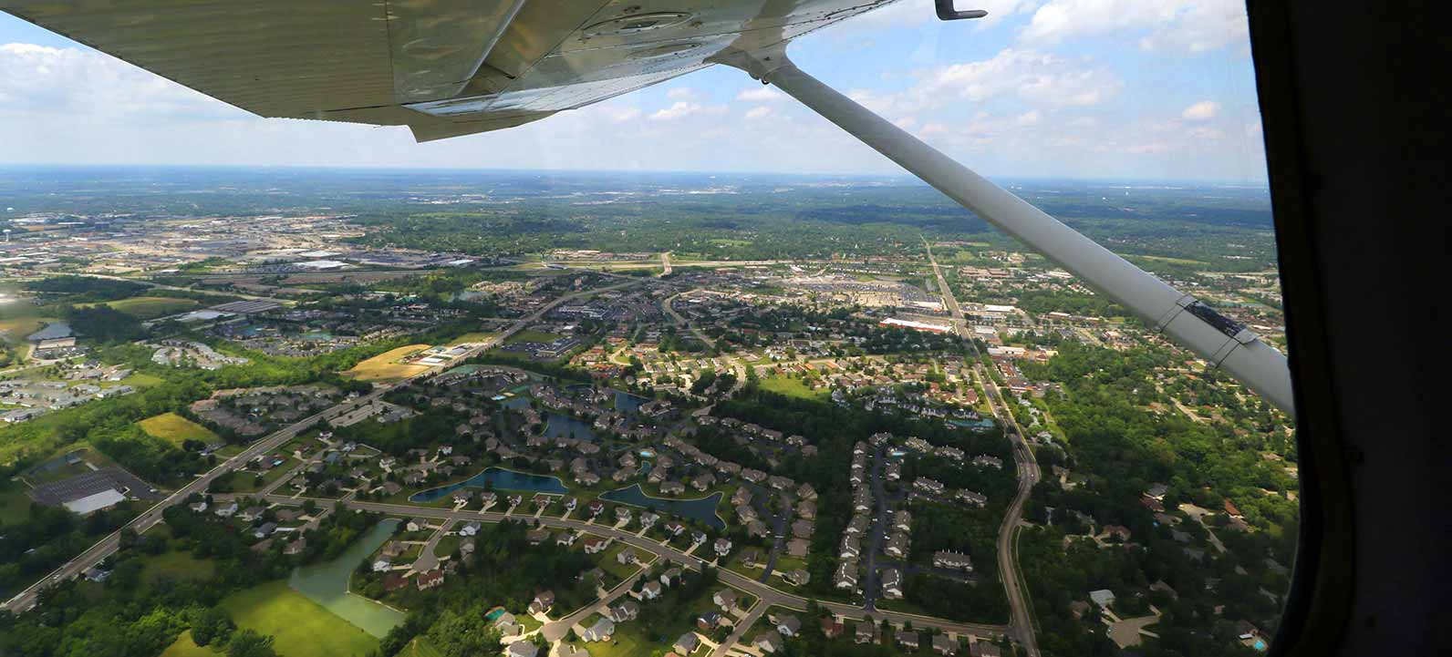 flying over neighborhood