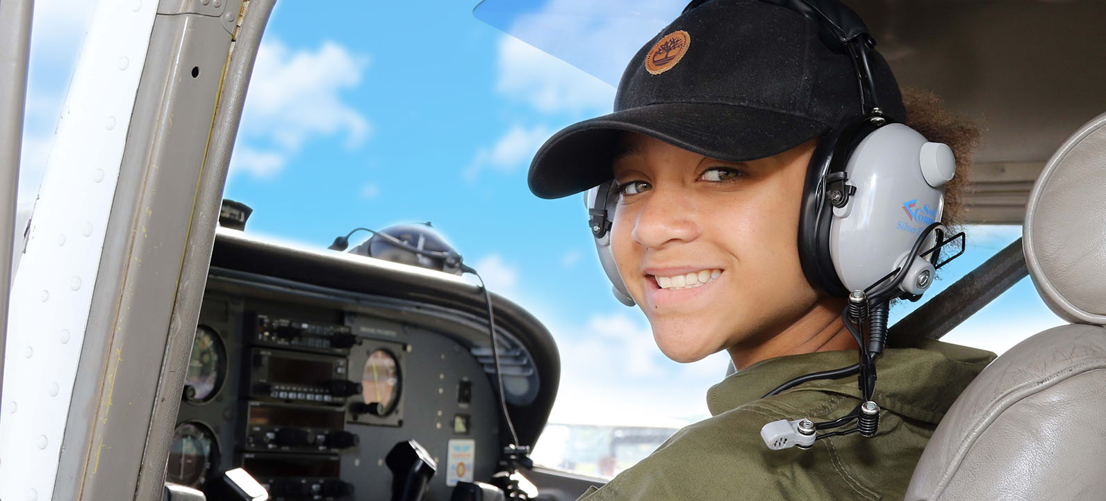 young lady in the pilot's seat