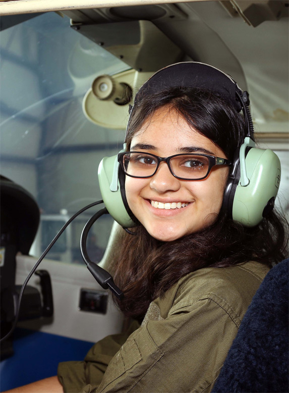 air camp student in pilot seat